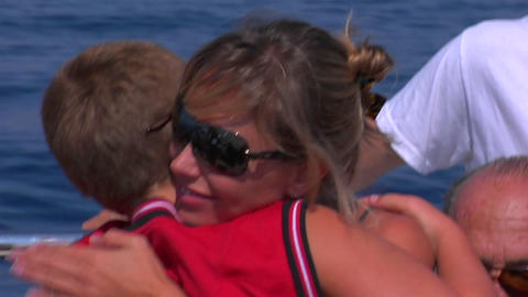 A mother hugs her son on a sailing trip Stock Video Footage