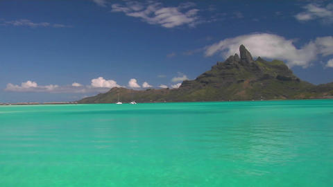 Bora bora's mountainous peak in the background with crystal turquoise waters in the foreground Footage