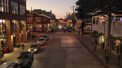 Fast time lapse at dusk of tourists on historic Cannery Row in Monterey, California Footage