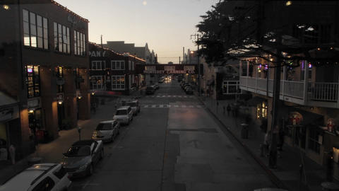Evening time lapse of tourists shopping on historic... Stock Video Footage