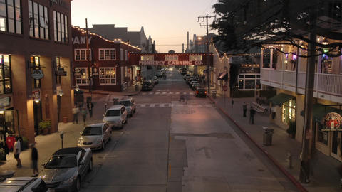 Evening time lapse of tourists shopping on historic Cannery Row in Monterey, California Footage