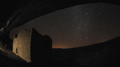 Time lapse of star trails above a Chacoan rock house in... Stock Video Footage