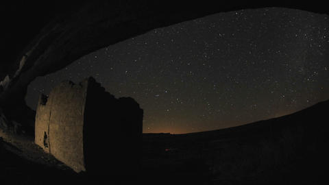 Time lapse of star trails above a Chacoan rock house in Gallo Wash in Chaco Culture National Histori Footage