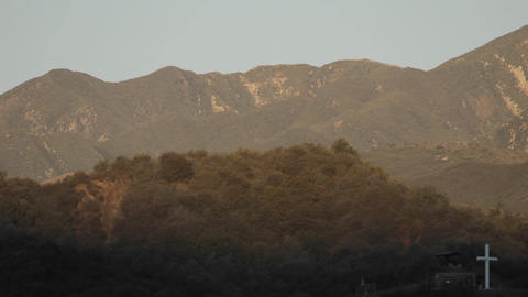 Time lapse of full moon setting behind mountains and... Stock Video Footage