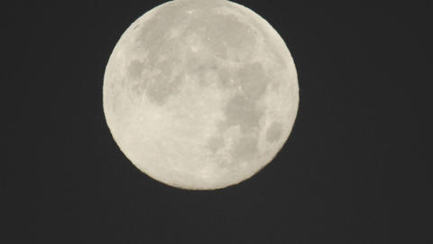Close-up time lapse of full moon setting in Oak View, California Footage