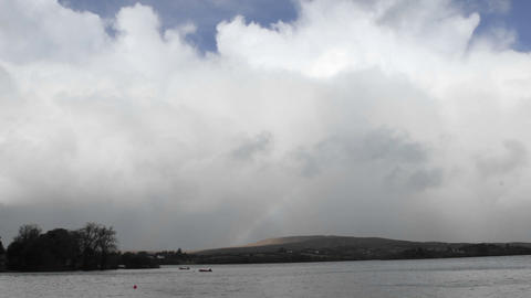 Time lapse of a rainbow over Gartan Lake near Glenveagh... Stock Video Footage