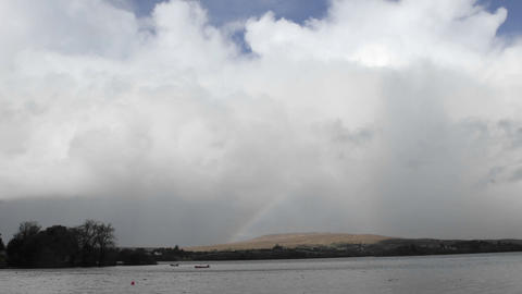 Time lapse of a rainbow over Gartan Lake near Glenveagh National Park, Ireland Footage