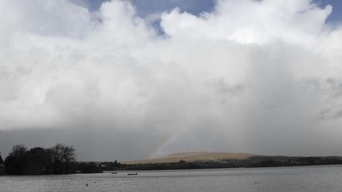 Time lapse of a rainbow over Gartan Lake near Glenveagh National Park, Ireland Footage