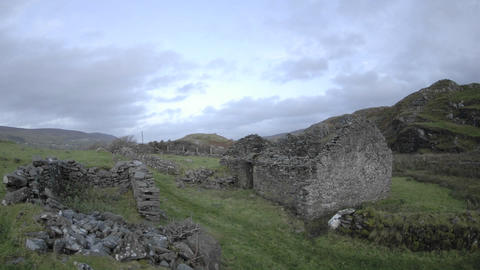 Time lapse of clouds blowing over the ruins in... Stock Video Footage