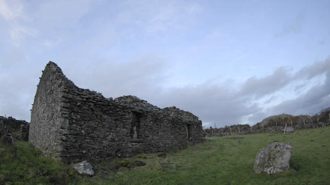 Panning time lapse of clouds blowing over the ruins in... Stock Video Footage