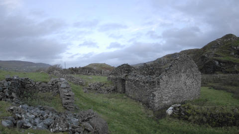Panning Time Lapse Of Clouds Blowing Over The Ruins In Glencolumbkille, County Donegal, Ireland stock footage