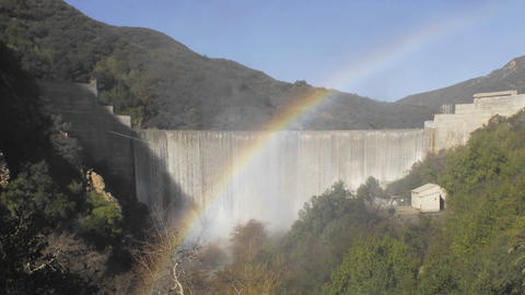Time lapse of rainbow moving across water spilling over the Matilija Dam after a rain in Ojai, Calif Footage
