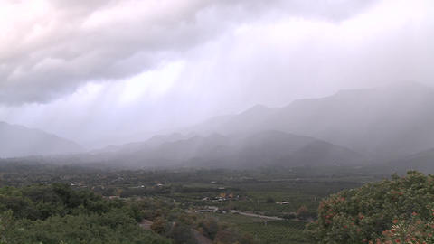 Time lapse of a snowstorm blowing over the Ojai Valley, California Footage