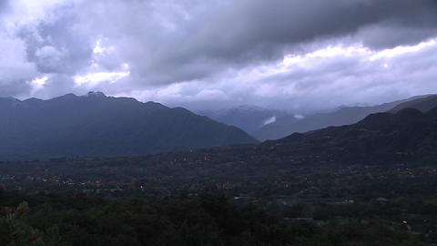 Evening time lapse of a snowstorm blowing over the Ojai Valley, California Footage