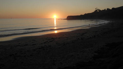 Time lapse of sun setting over the Pacific Ocean at Refugio Beach State Park, California Footage