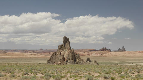 Time lapse of clouds passing over Church Rock and Comb Ridge on the Navajo Indian Reservation near K Footage