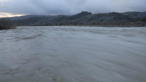 Time lapse of the Ventura River flooding and a rain squall in Oak View, California Footage