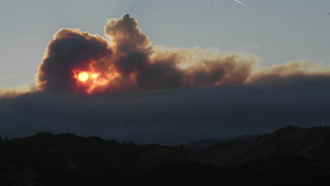 Close-up time lapse of a smokey sunset from wildfires in the Santa Ynez Mountains, California Footage