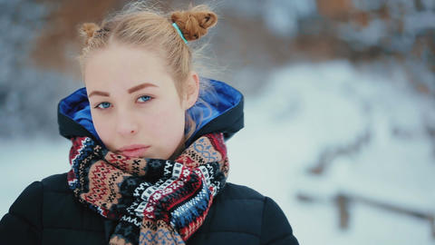 Portrait of Cute Blue-eyed Young Woman GIF