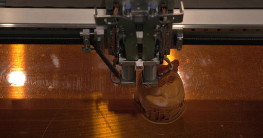 Close-up of mechanism of 3D printer working on printing plastic toys Footage