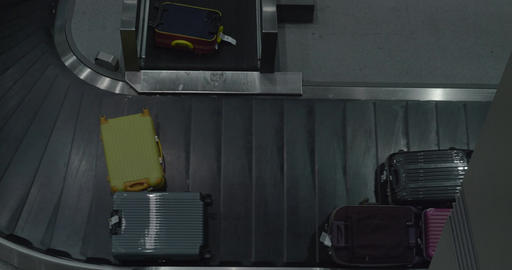 Suitcases on luggage conveyor at the airport Footage