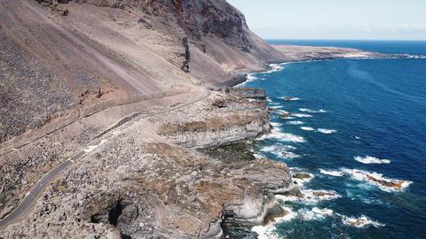Scenic aerial coastline landscape. Cliffs and shoreline in volcanic landscape Live Action