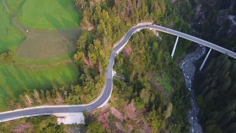 Scenery of road and bridge with green environment on the sides Live Action