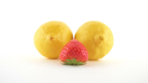 Close-up isolated on white background lemon and strawberry Live Action