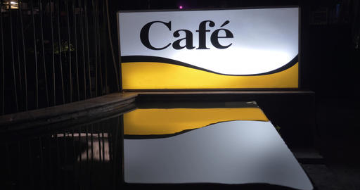 Illuminated cafe banner at night Live Action