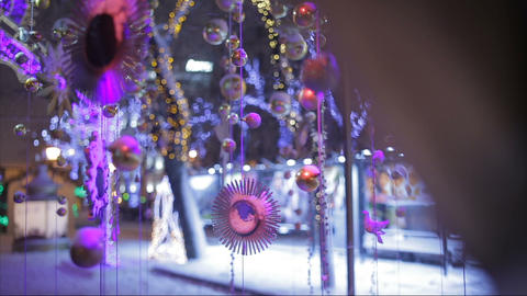 Snow falls on Christmas toys and decorations on the street Footage