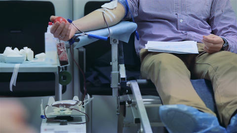 Male donor donates blood voluntarily Footage