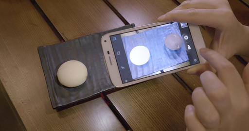 Taking picture of Mochi dessert with mobile phone Footage