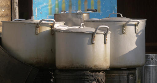 Steaming cooking pots in the street Footage