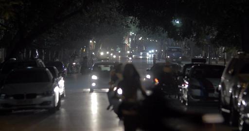 Motorbikes and cars in night Hanoi, Vietnam Footage