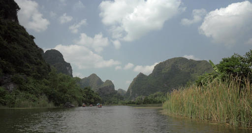 Trang an bai in Hanoi, Vietnam on a scenic river sailing boat with tourists Footage