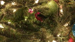 Ornaments Hanging Along Tree Timelapse Footage