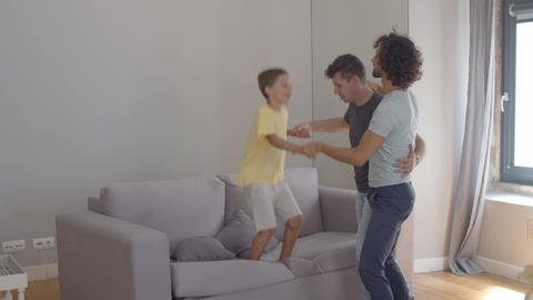 Cheerful active boy enjoying home activity Live Action