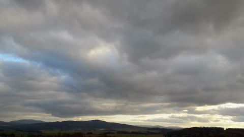 Cloud time lapse, white cumulus clouds on sky with mountain and meadow, Czech landscape Live Action