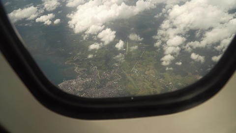 View from an airplane window on the ocean Live Action