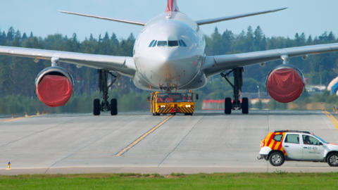 Airliner being towed for maintainance Live Action
