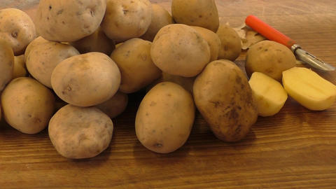 Fresh potatoes on rustic wooden background Footage