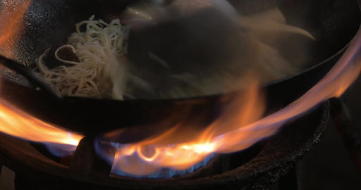 Making noodles dish in wok on gas fire, Thailand Footage