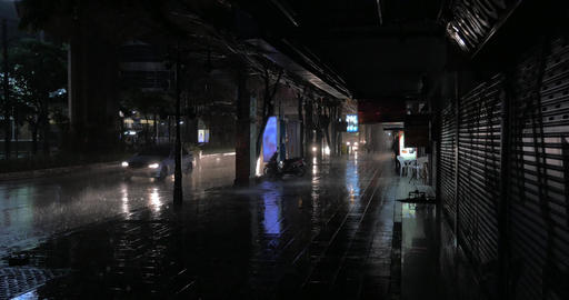 Rain pouring at night Bangkok, Thailand Footage