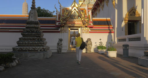 Woman tourist exploring Marble Temple in Bangkok, Thailand Footage