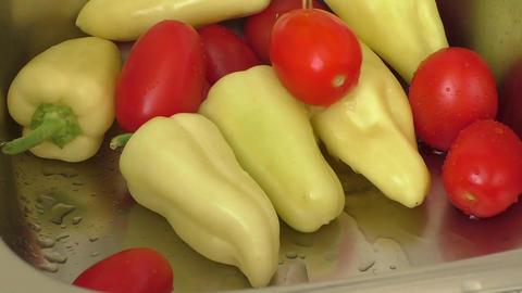 Fresh vegetables splashing in water before cooking Footage