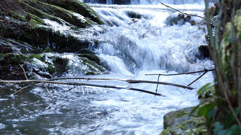 Frozen icicles on a mountain stream in the morning Footage