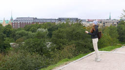 Woman take panoramic picture from park hill, using smartphone camera Live Action