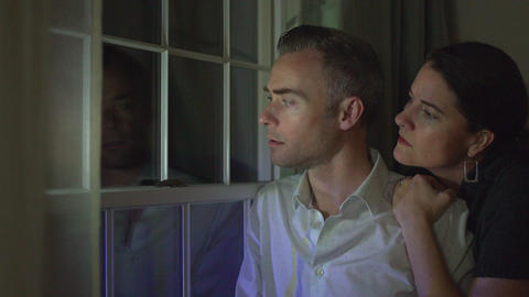 a couple is fearful of a crime outside Footage