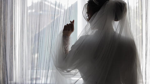 Beautiful and lovely bride in night gown and veil. Wedding morning preparation Live Action