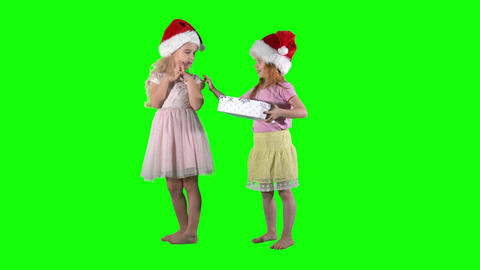 Little girl give gift box for best friend. Happy curious children. Chroma key Live Action